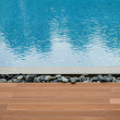 Platform beside swimming pool — Stock Photo #58413069