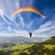 Paraglider flying over mountains — Stock Photo #55666321