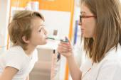 Cute boy being checked at clinic — Stock Photo