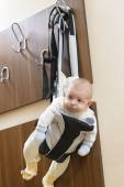 Baby in a hanger — Stock Photo