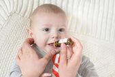 Newborn baby gets medicine — Stock Photo