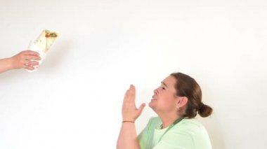 Corpulent woman having addiction to unhealthy food — Stock Video
