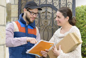 Courier Delivering a Package  — Stockfoto