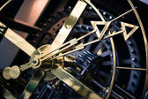 Steel clock detail, side view, hands close — Stock Photo