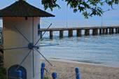 Small windmill on the beach — Stock Photo