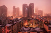 Scene of cites covered by fog. — Stock Photo
