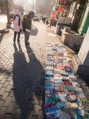 People searching for second hand books on the street — Stock Photo