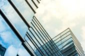 Skyscraper with reflection of tree branch — Stock Photo