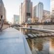 Постер, плакат: People at Cheonggyecheon stream