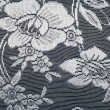 Lace on black and white fabric — Stock Photo #67955691
