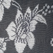 Lace on black and white fabric — Stock Photo #67955739