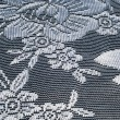 Lace on black and white fabric — Stock Photo #67955807