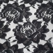 Lace on black and white fabric — Stock Photo #67955891