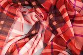 Silk fabric texture. red cell — Stok fotoğraf