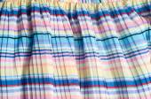 Pleated fabric. Sinii yellow red white stripes texture — Stock Photo