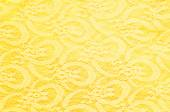 The texture of fabric lace, bright yellow — Stock Photo