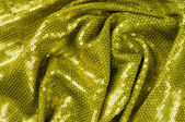 Fabric texture with green sequins — Stock Photo
