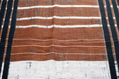 Cotton fabric texture. Brown black white stripe pattern fabric — Stock Photo