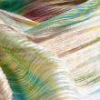 Pleated fabric with colorful abstract drawings — Stock Photo #73743933