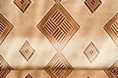 Beige silk fabric texture with diamond pattern — Stock Photo