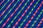 Batiste fabric texture. striped coloring, red green blue white s — Stock Photo