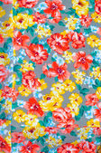 Texture silk cloth. Yellow red flowers painted on cloth — Stock Photo