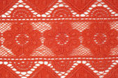 Red lace fabric texture — Stock Photo