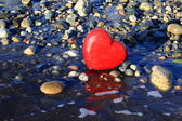 Red heart on the beach. — Stock Photo