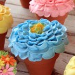 Spring flower cupcakes in pots. — Stock Photo #67271843