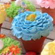 Spring flower cupcakes in pots — Stock Photo #67271879