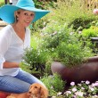 Lady gardener with dog.  — Stock Photo #73399375