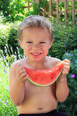 Boy eating slice of watermelon — Stock Photo