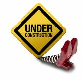 Construction sign fallen on the wicket witch — Stock Photo