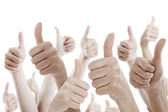 Many people holding their thumbs up — Photo