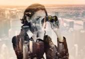 Double exposure of businesswoman with binocular and megalopolis — Stock Photo