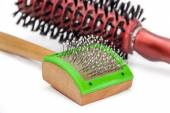 Comb for cats on a background of hair brushes — Stock Photo