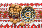 Two bowl and nuts on the tablecloth — Stock Photo