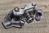 Old camera and films — Stock Photo