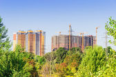 Building with trees in the foreground — Stock Photo