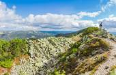 Mountain autumn landscape with single tourist on the ridge — Stock Photo