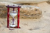 Sand timer in sand — Stock Photo