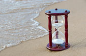 Sand timer on the seashore — Stock Photo