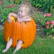 Little Caucasian girl Halloween pumpkin — Stock Photo #52676463