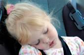 Little girl sleeping in car seat — Stock Photo