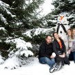 Family with Christmas snow tree — Stock fotografie #59190001