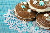 Chocolate whoopie pie on snowflake — Stock Photo