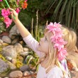 Little girl painting a flower — Stock Photo #61521029