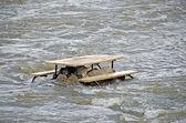 Picnic table in a river — Fotografia Stock