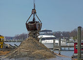 Dredger dredging marina slip — Stock Photo