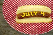 Hot dog on bun with mustard for 4th of July — Stock Photo